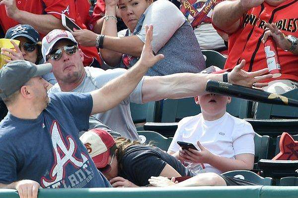 Fast-acting-dad-deflects-baseball-bat-headed-for-sons-face