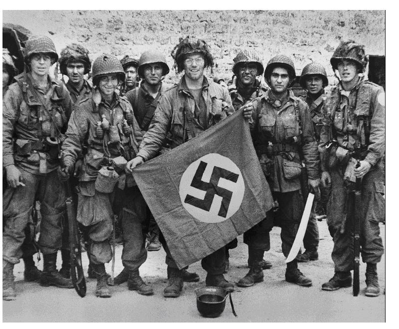 american-paratroopers-proudly-display-a-nazi-flag-captured-after-they-made-a-successful-landing-behind-the-german-lines-on-the-normandy-coast-of-france-on-june-9-1944-ap-photo.jpg